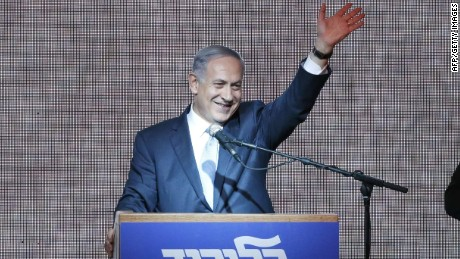 Israeli Prime Minister Benjamin Netanyahu waves from the stage as he reacts to exit poll figures in Israel's parliamentary elections late on March 17, 2015 in the city of Tel Aviv. Netanyahu claimed victory in elections as exit polls put him neck-and-neck with centre-left rivals after a late fightback in his bid for a third straight term. AFP PHOTO / JACK GUEZJACK GUEZ/AFP/Getty Images