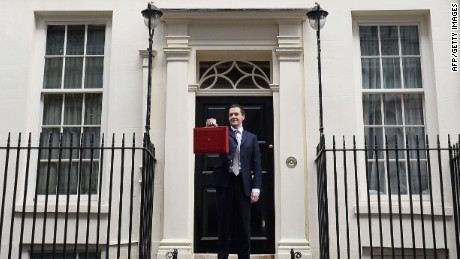 British Finance Minister George Osborne poses for pictures with the Budget Box as he leaves 11 Downing Street in London, on March 18, 2015, before presenting the governments annual budget to parliament. Britain's coalition government unveils a highly political budget Wednesday that will set the stage for a knife-edge election battle in 50 days' time. AFP PHOTO / BEN STANSALLBEN STANSALL/AFP/Getty Images