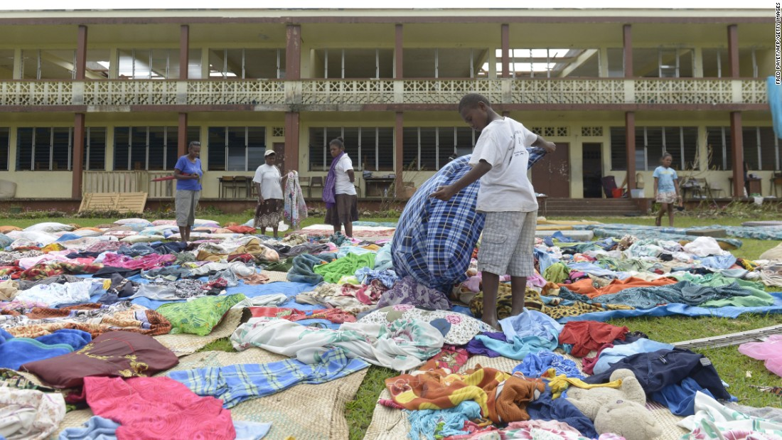 People put clothes out to dry near Port Vila on March 19.