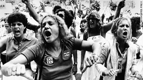 "Equal Rights Amendment supporters voice their disapproval of the 22-16 vote against E.R.A. in the Florida Senate as they streamed out of the capitol for a demonstration and shouted ""vote them out"" in response to the Senate vote, June 21, 1982."