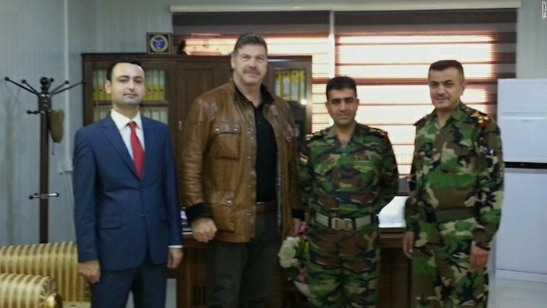 Tony Sinnott and Yakhi Balak from the 1st North American Expeditionary Force attend a liaison meeting with Peshmerga Brigadier General Hajar Osman Ismael and his deputy.