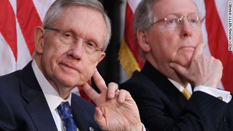 Then-U.S. Senate Majority Leader Sen. Harry Reid (D-NV) (left) and Then-Senate Minority Leader Sen. Mitch McConnell (R-KY) (right) listen during a dedication ceremony of the statue of former President Gerald Ford at the Rotunda of the Capitol May 3, 2011 on Capitol Hill in Washington, D.C.