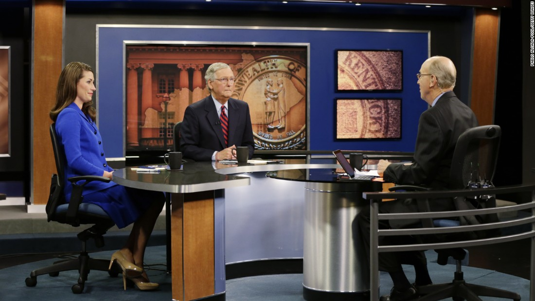 "McConnell and Kentucky Secretary of State Alison Lundergan Grimes, his Democratic opponent in the 2014 election, sit with ""Kentucky Tonight"" host Bill Goodman before their debate in October in Lexington."