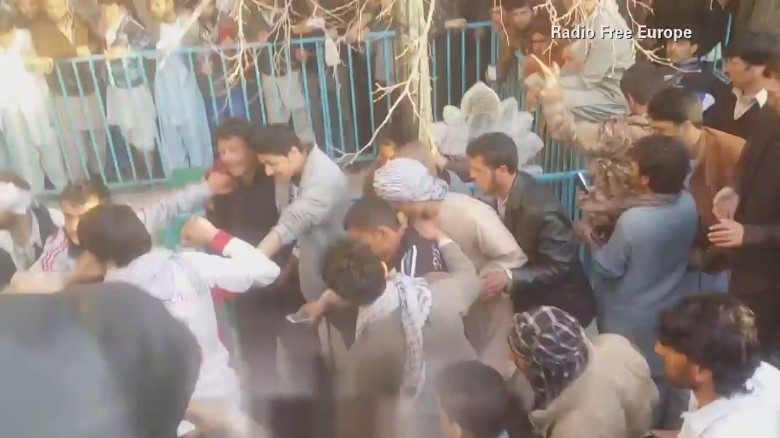 Afghan woman beaten to death by crowd