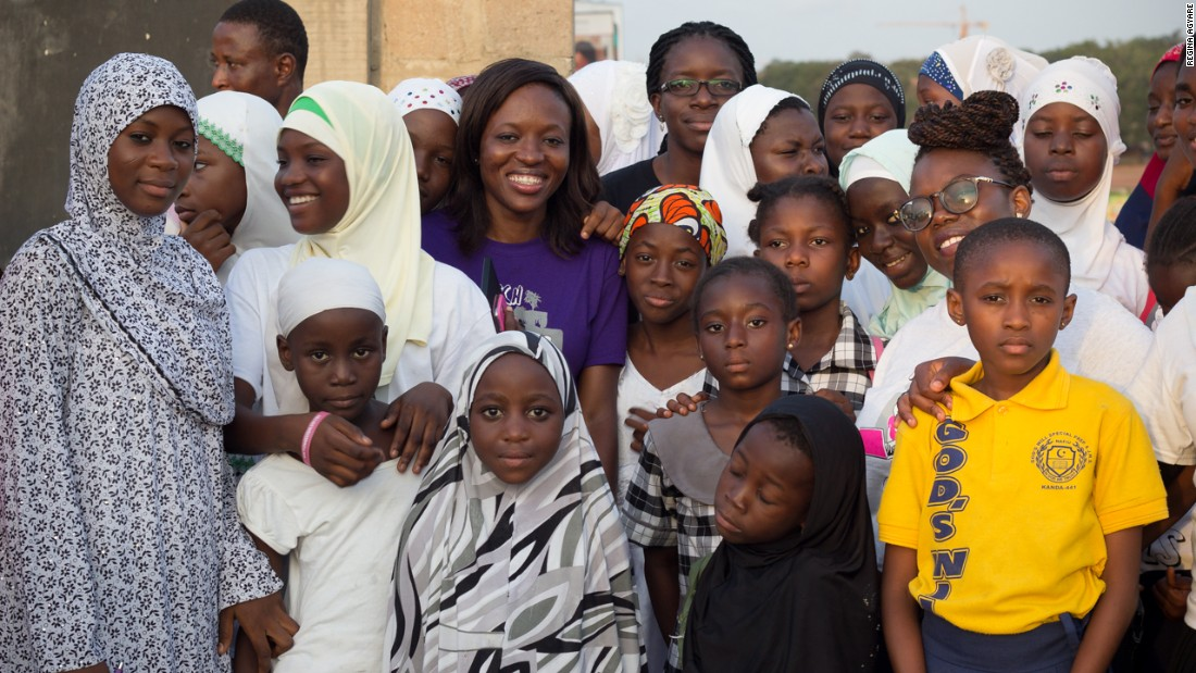 Tech entrepreneur and mentor Regina Agyare, center, pictured  with some of her students in Nima.
