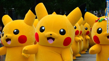Dozens of Pikachu characters, the famous character of Nintendo's videogame software Pokemon, parade at the Landmark Plaza shopping mall in Yokohama, suburban Tokyo on August 14, 2014. The Pikachu mascots walk around daily to attract summer vacationers as a part of the 'Great Pikachu Outbreak' event through the weekend. AFP PHOTO / Yoshikazu TSUNO (Photo credit should read YOSHIKAZU TSUNO/AFP/Getty Images)