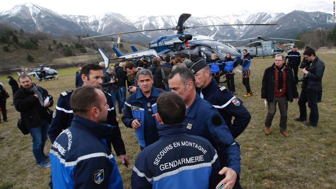 Rescue workers and members of the French Gendarmerie gather in Seyne-les-Alpes on Tuesday, March 24, as search-and-rescue teams struggle to reach the remote crash.
