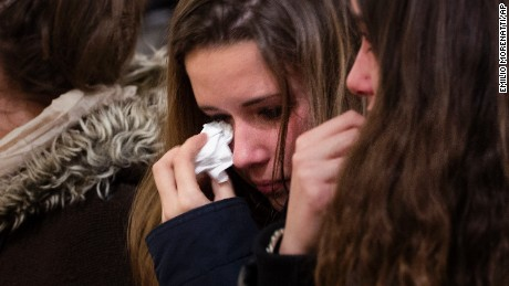 A girl wipes away tears during a mass on March 24 in Llinars del Valles, near Barcelona, Spain.
