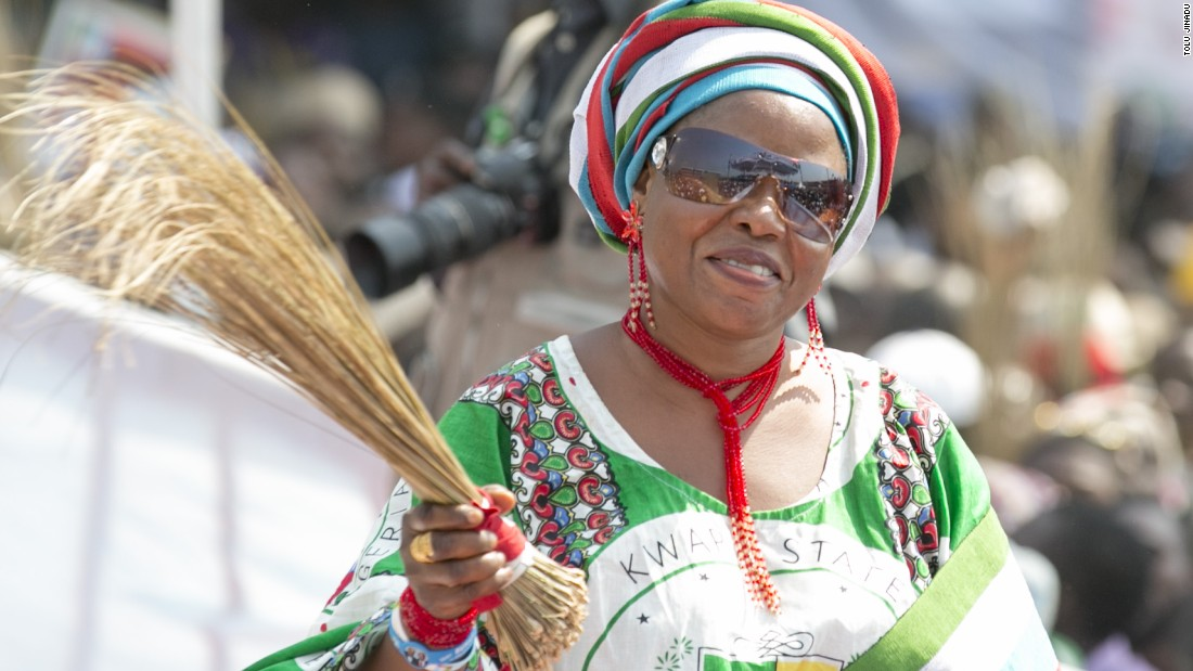 An APC supporter waves a broom, the party's symbol, at a rally in Lagos on January 30.<br />