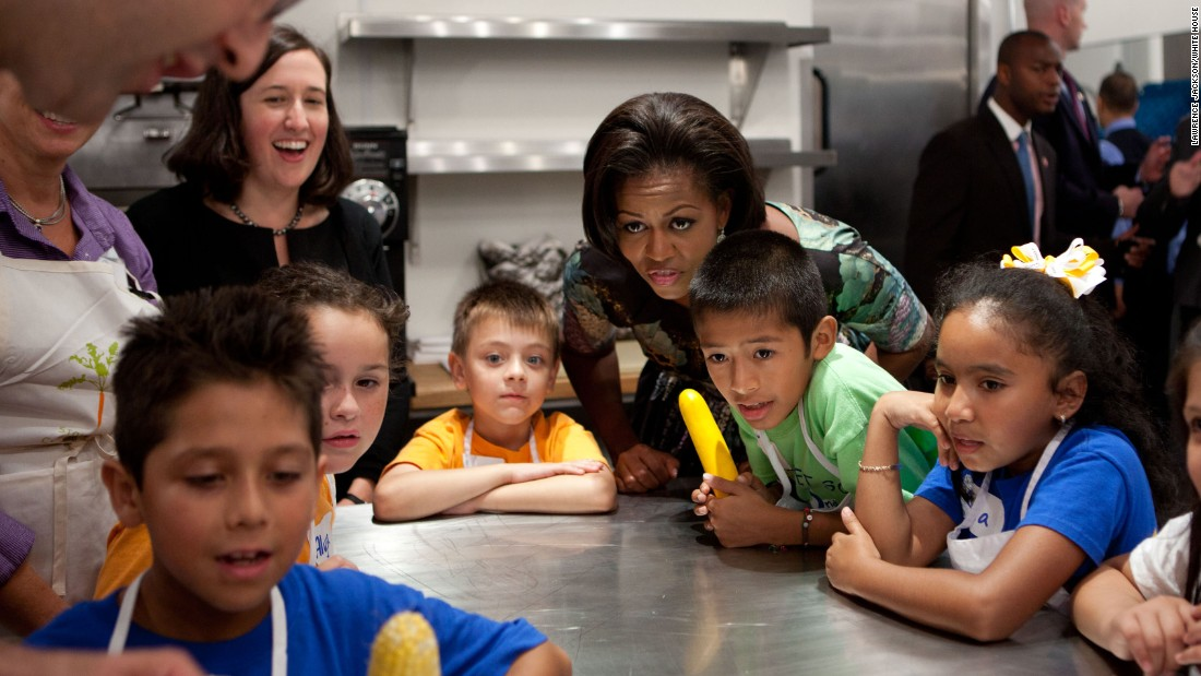 The first lady attends a chef's demonstration with third-grade students from Pocantico Hill School and John F. Kennedy Magnet School, before a luncheon at Blue Hill Farm in Pocantico Hills, New York, in 2010.