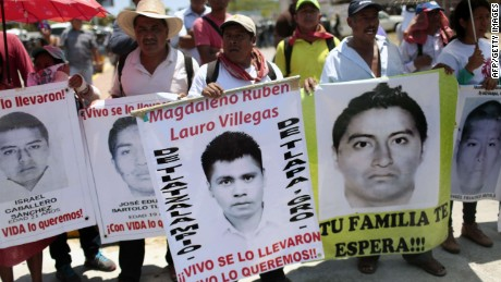 Parents and relatives of the 43 students from Ayotzinapa participate in a protest in Acapulco, Guerrero State, Mexico on March 24, 2015 demanding justice on their disappearance and on the death of teacher Claudio Castillo killed during a protest on February 24. AFP PHOTO/ PEDRO PARDOPedro PARDO/AFP/Getty Images
