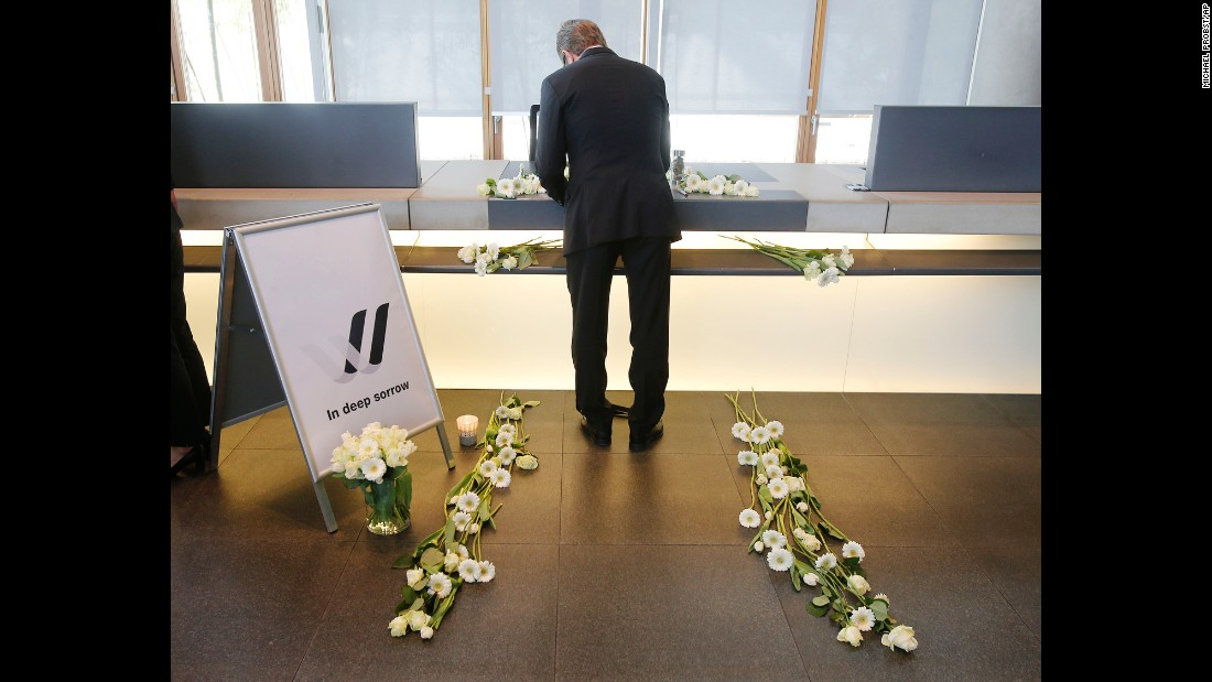 A Lufthansa employee signs a condolence book in Frankfurt, Germany, on March 25.