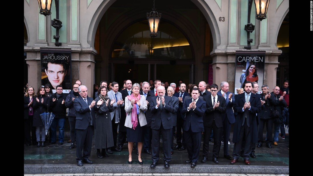 Employees and trustees of the opera house Gran Teatre del Liceu in Barcelona, Spain, gather March 25 to honor Oleg Bryjak and Maria Radner, two opera singers who were aboard the flight.