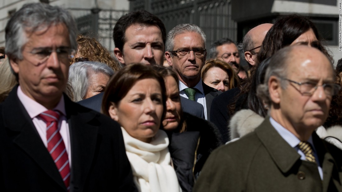 Employees and members of the Spanish Parliament hold a moment of silence in Madrid on March 25.