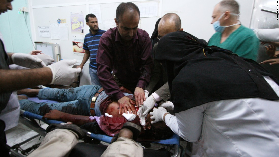 Medics treat an anti-Houthi protester who was injured during clashes with pro-Houthi police in Taiz on March 24.
