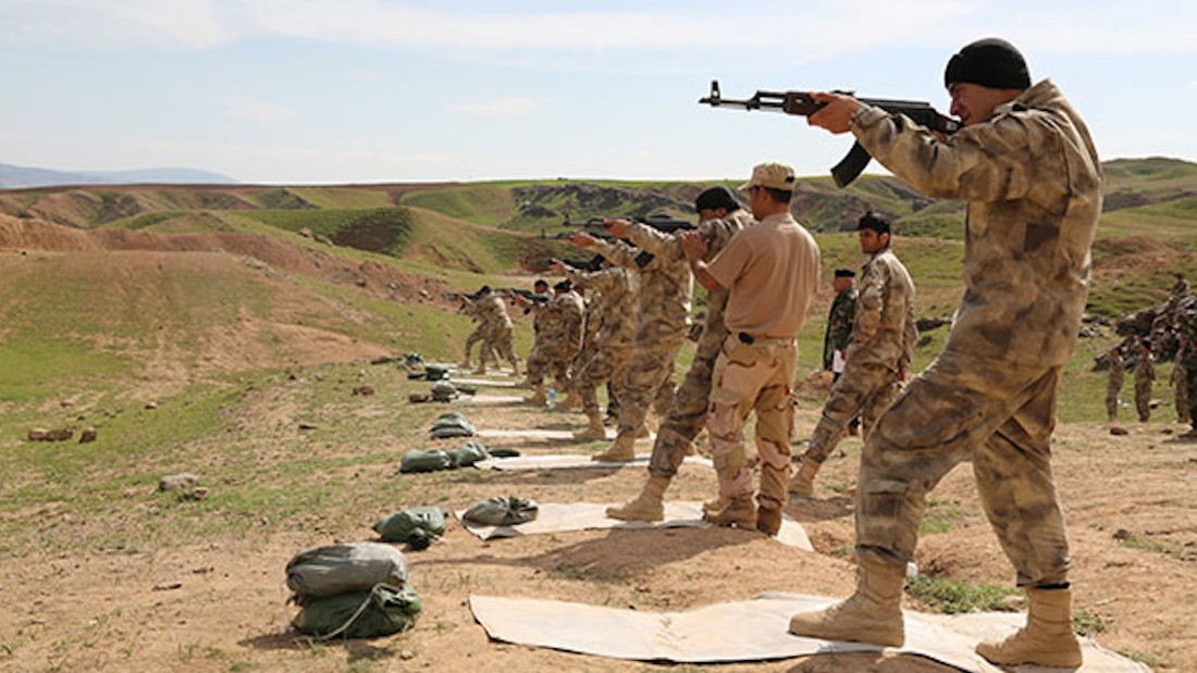 Militiamen recruits receive firing range training in Chamchamal, Iraq, from SOLI instructors.