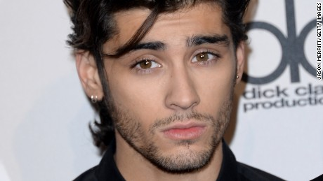 Singer Zayn Malik of One Direction, winners of Artist of the Year, Favorite Pop/Rock Band/Duo/Group and Favorite Pop/Rock Album, poses in the press room at the 2014 American Music Awards at Nokia Theatre L.A. Live on November 23, 2014 in Los Angeles, California.