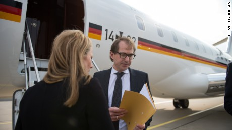 German Transport Minister Alexander Dobrindt (R) prepares to board a plane in Berlin to travel to the French Alpine region where a German passenger plane crashed, killing all 150 people tohgether with with the German foreign minister on March 24, 2015. The head of low-budget airline Germanwings said there were 144 passengers and six crew on the Airbus A320 that crashed in the French Alps en route to Duesseldorf from Barcelona. AFP PHOTO / DPA / OLIVER BERG +++ GERMANY OUT +++BERND VON JUTRCZENKA/AFP/Getty Images