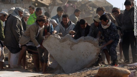 Yemeni civilians and security forces search for survivors in rubble after Saudi airstrikes against Houthi rebels near Sanaa Airport on March 26.