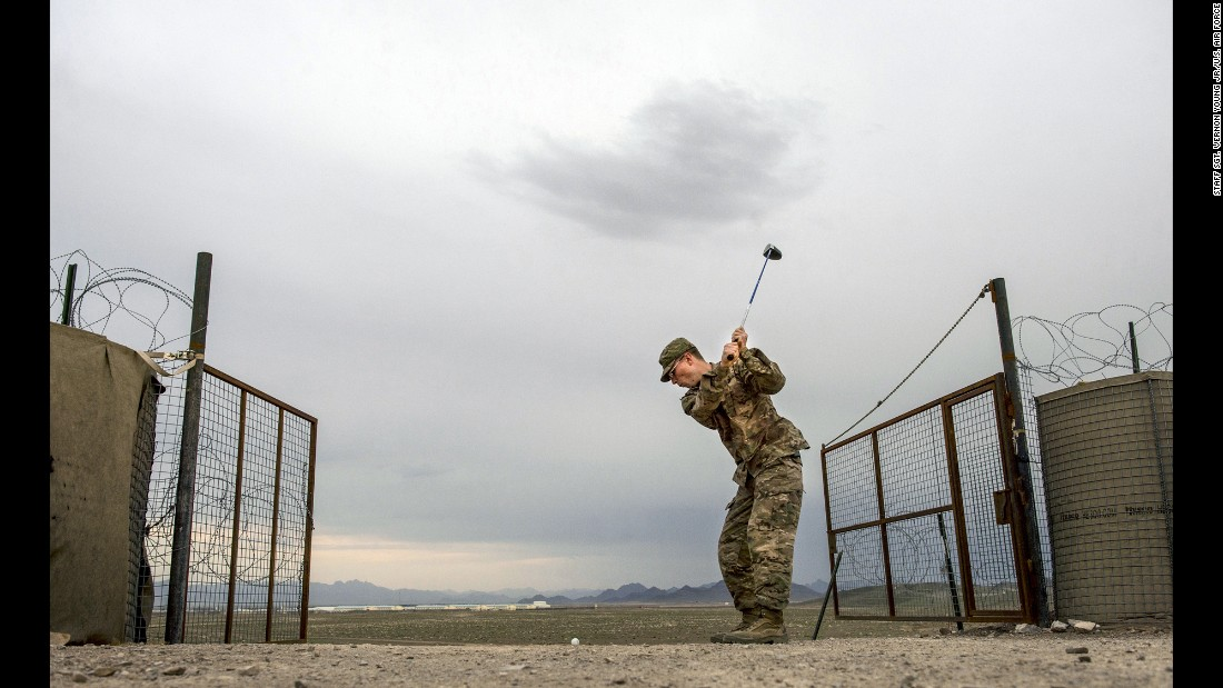 An off-duty U.S. Army soldier hits golf balls in Afghanistan on March 29, 2014. Military members try to  maintain a healthy balance of physical and social activities during their deployments.