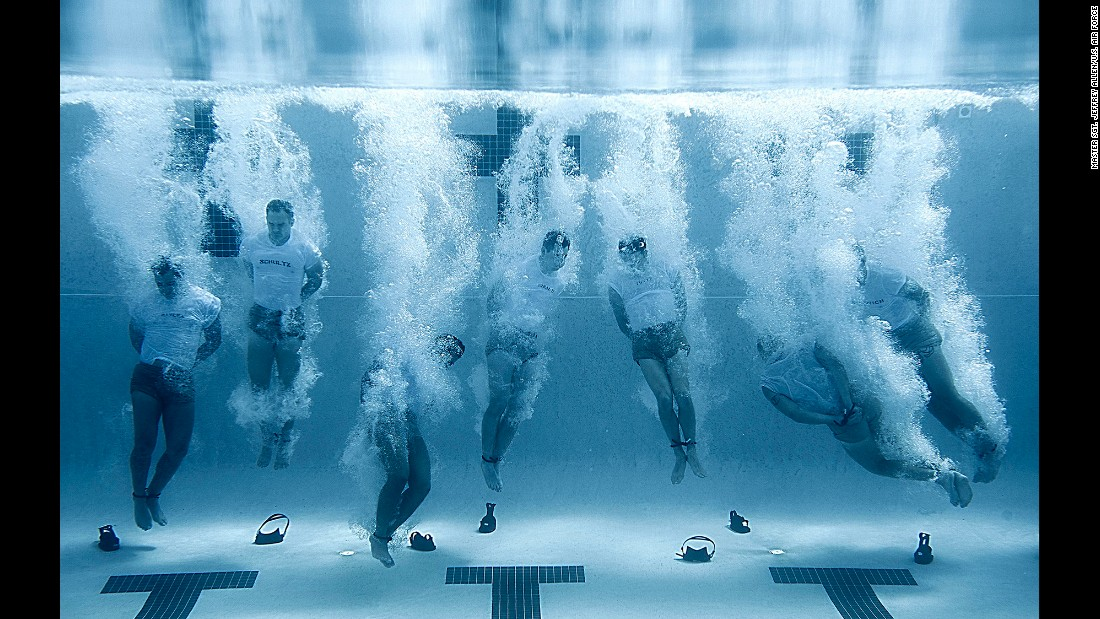 Members of the Air Force's Special Tactics Training Squadron plunge into a swimming pool with their hands and feet bound before bouncing up to the surface to breathe. The drown-proofing exercise teaches students to remain calm in water during a stressful situation -- a skill that is vital during real-world operations.