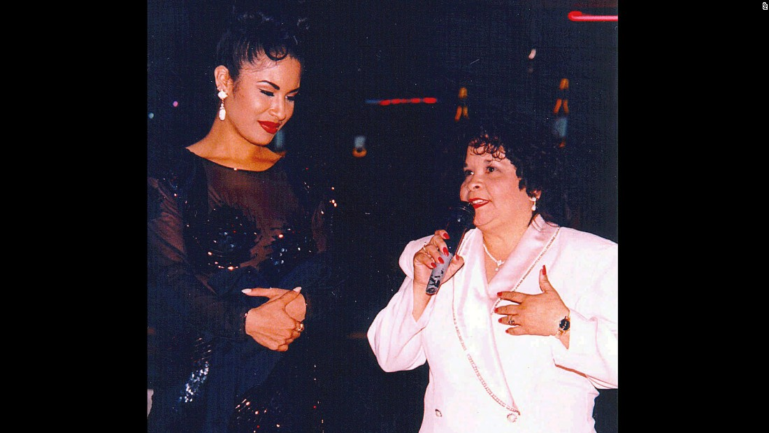 Selena stood by as her fan club president, Yolanda Saldivar, spoke at a 1994 Tejano Music Awards party in San Antonio, Texas. Saldivar was later convicted of first-degree murder for shooting and killing Selena in a Corpus Christi motel room on March 31, 1995.