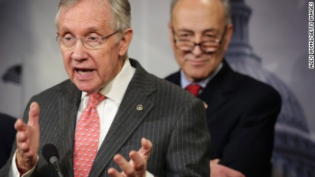 U.S. Senate Majority Leader Sen. Harry Reid (D-NV) (left) speaks as Sen. Charles Schumer (D-NY) (right) listens during a news conference March 26, 2014 on Capitol Hill in Washington, D.C.