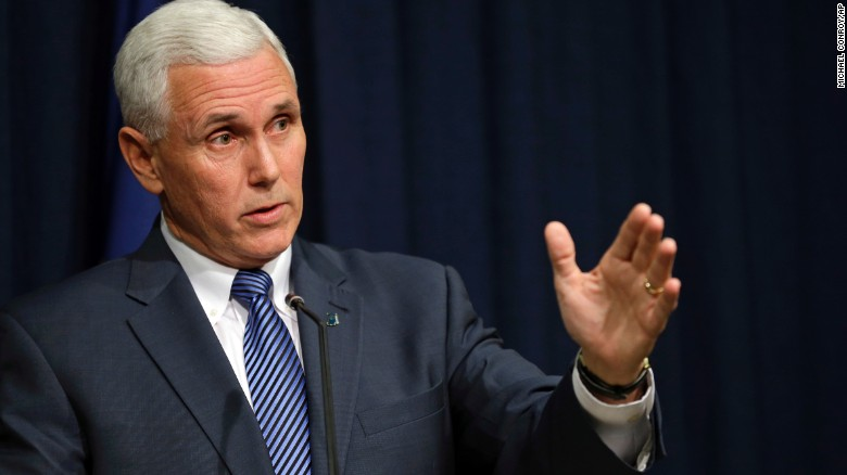 Indiana Gov. Mike Pence holds a news conference at the Statehouse in Indianapolis, Thursday, March 26.