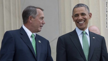 U.S. President Barack Obama walks with Speaker of the House John Boehner as they depart the annual Friend's of Ireland luncheon on Capitol Hill in Washington, DC, March 17, 2015.