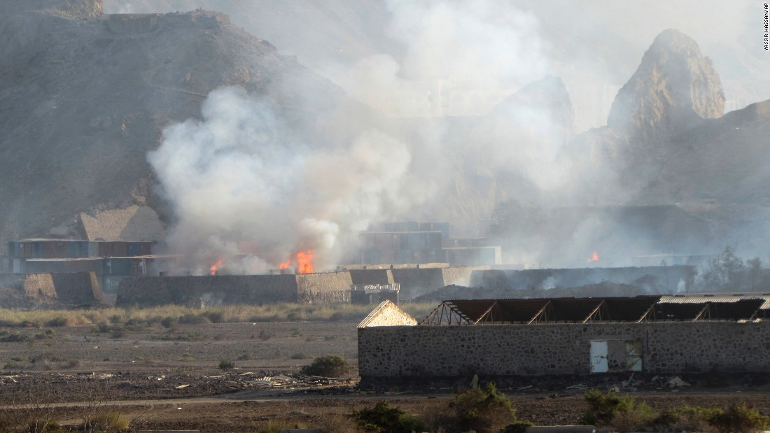 Buildings burn at the Jabal al-Hadid military camp in Aden on Saturday, March 28. Yemeni military officials said an explosion rocked the camp that houses a weapons depot, killing and wounding several people. The camp reportedly had been taken by security forces loyal to former Yemeni President Ali Abdullah Saleh. Some of the forces aligned with the Houthis are also loyal to Saleh, who resigned in 2012 after months of Arab Spring protests.