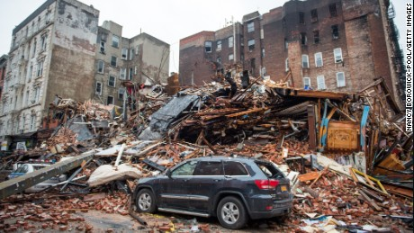 Boards and bricks litter the site after a gas explosion on March 26, 2015 destroyed buildings in New York's East Village.