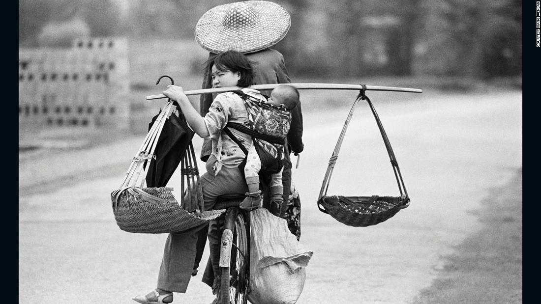 A family travels by bike in Guangxi, 1988. The bicycle once was a family's most precious asset.