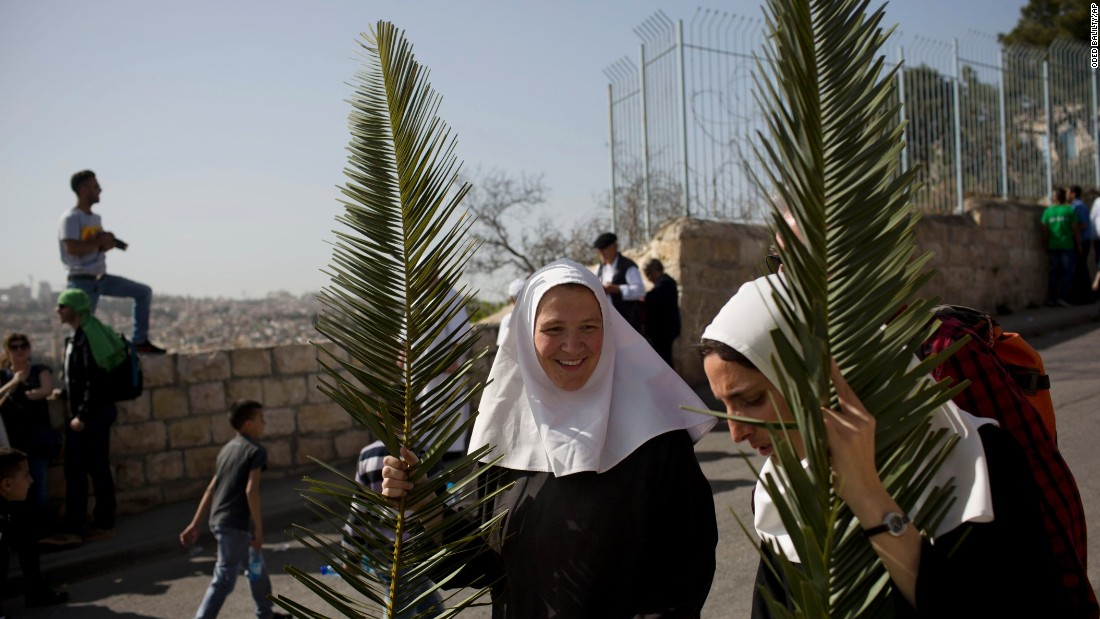 Nuns hold palm fronds during a Palm Sunday procession on the Mount of Olives, overlooking Jerusalem's Old City on March 29.
