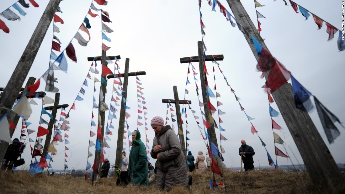Catholics pray on a hill with wooden crosses in Oshmiany, Belarus, on March 29.