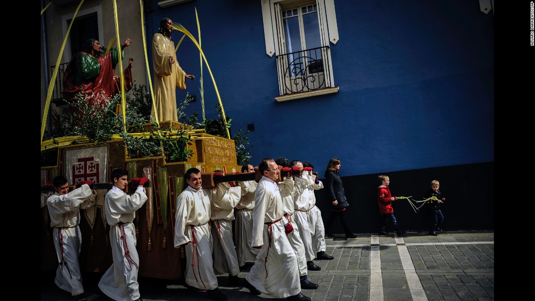 Penitents take part in a Palm Sunday procession in Pamplona, Spain, on Sunday, March 29. For Christians, Palm Sunday marks Jesus Christ's entrance into Jerusalem, when his followers laid palm branches in his path.