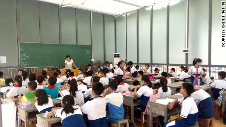 Students sit in an open glasses classroom in China for their lessons.