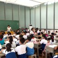 Pupils siiting in an open glasses classroom in China