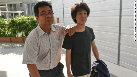 Amos Yee arrives at court with his father in March.