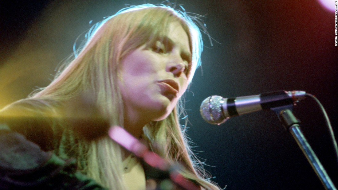 "The Canadian singer performs in an undated photograph. She was inducted into the <a href=""https://rockhall.com/inductees/joni-mitchell/"" target=""_blank"">Rock and Roll Hall of Fame</a> in 1997."