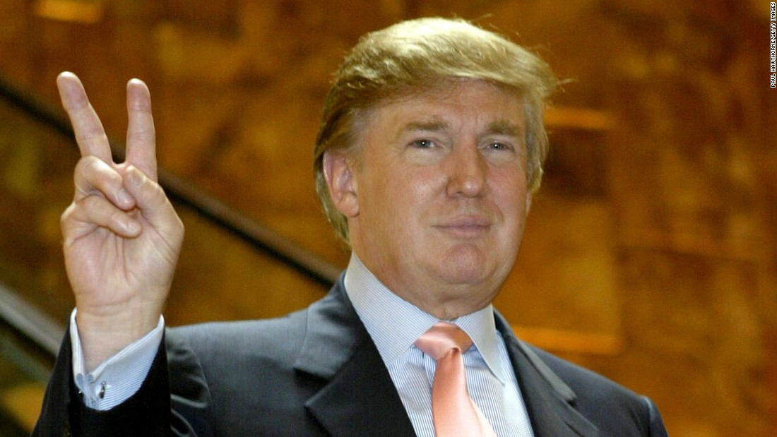"Trump arrives at ""The Apprentice"" casting call in Trump Tower on July 30, 2004, in New York City."