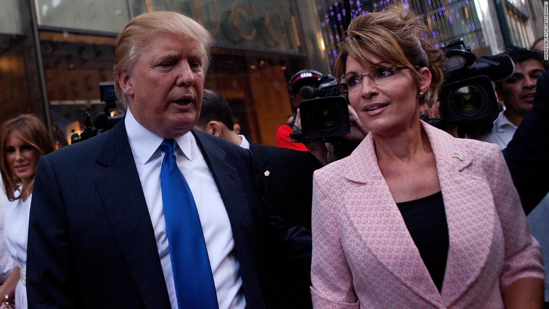 Former U.S. vice presidential candidate and Alaska Gov. Sarah Palin and Trump walk toward a limousine after leaving Trump Tower, at 56th Street and Fifth Avenue, on May 31, 2011, in New York City.