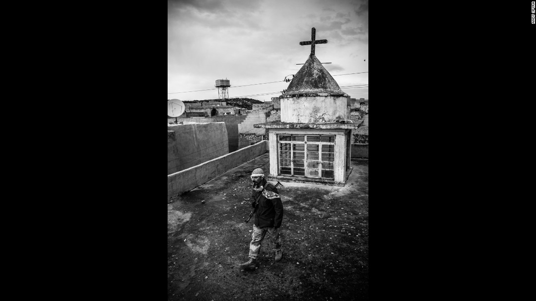 A Dwekh Nawsha fighter on the rooftop of a church in Baqufa. There are about 300,000 Christians in Iraq today, compared with 1.5 million 20 years ago, according to Christian relief organization CAPNI.
