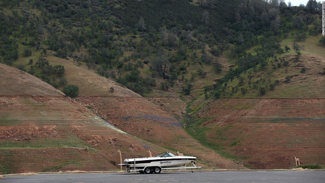 In March 2015, a power boat sits on a Lake McClure parking lot that used to be underwater in La Grange, California.