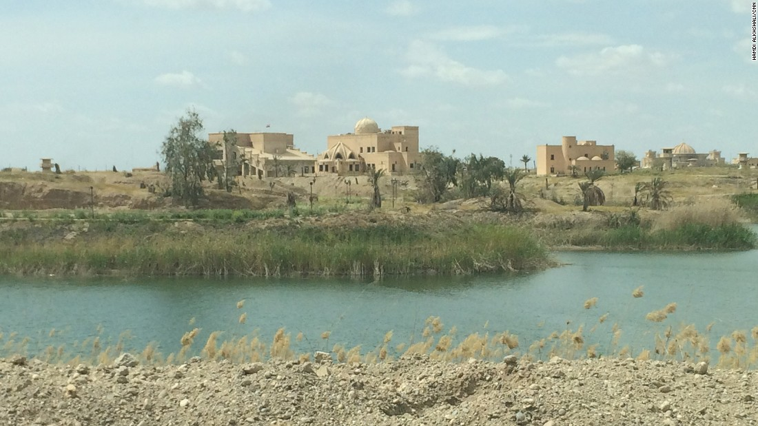 "A distant view of the palace. While it remains standing,<a href=""http://cnn.com/2015/03/16/middleeast/iraq-isis-babylon-safe/""> the tomb of the former dictator was flattened</a> in the outskirt of the town of Awja earlier last month."