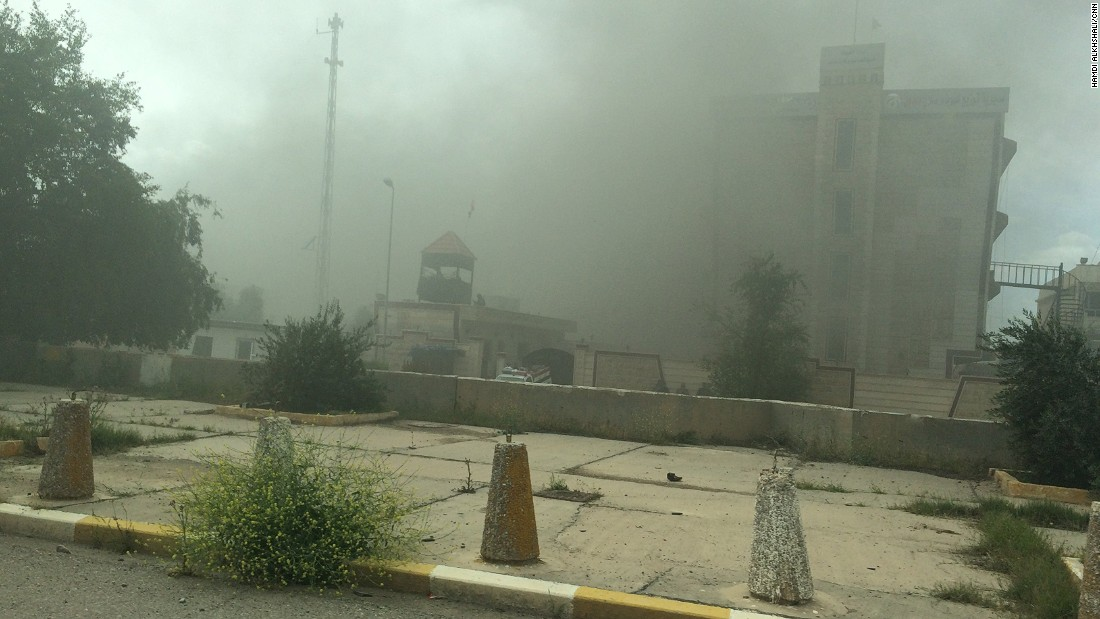 Smoke rises from a government building. As Iraqi forces, aided by Shiite militiamen, took control of Tikrit on April 1, they found vehicles laden with explosives and buildings that might be booby-trapped.