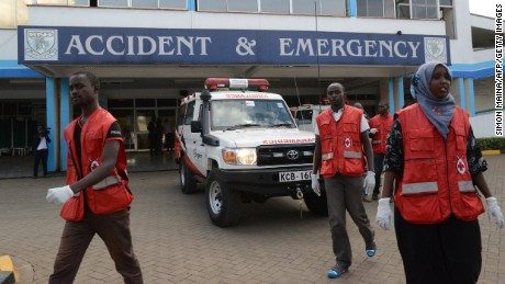 Members of the Kenyan Red Cross gather outside the Kenyatta hospital in Nairobi on April 2.