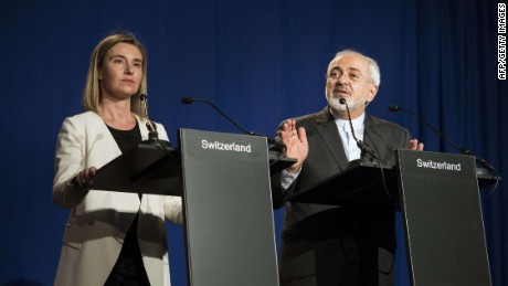 Iranian Foreign Minister Javad Zarif (R) delivers a statement, flanked by European Union High Representative for Foreign Affairs and Security Policy Federica Mogherini, at the Swiss Federal Institute of Technology in Lausanne (Ecole Polytechnique Federale De Lausanne) on April 2, 2015, after Iran nuclear program talks finished with extended sessions. European powers and Iran on April 2 hailed a breakthrough in talks on reaching a deal to curtail Tehran's nuclear programme. AFP PHOTO / POOL / BRENDAN SMIALOWSKIBRENDAN SMIALOWSKI/AFP/Getty Images