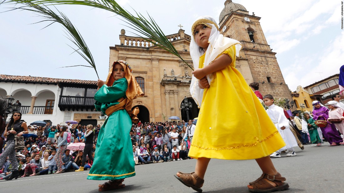 Boys dressed as shepherds take part in the Children's Holy Thursday Procession in Tunja, Colombia, on April 2. In this annual procession, now in its 55th year, children depict the key moments of the passion, death and resurrection of Christ.