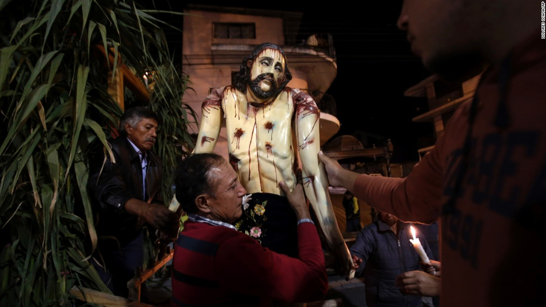 "A man carries away a sculpture of Jesus after it was paraded at a nighttime Holy Week procession in Puellaro, Ecuador, on Tuesday, March 31. The procession, called ""Procesion de Andas,"" is an annual tradition. Those who carry the heavy sculptures on large platforms inherit the responsibility from their parents or a friend and consider it an honor."