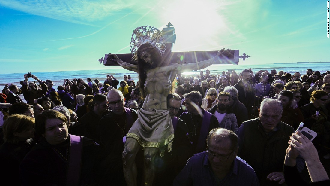 An effigy of Jesus Christ is at the center of a Holy Week procession on the beach in Valencia, Spain, on April 3.